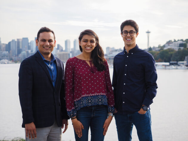 Yoodli's founders with Seattle skyline in background